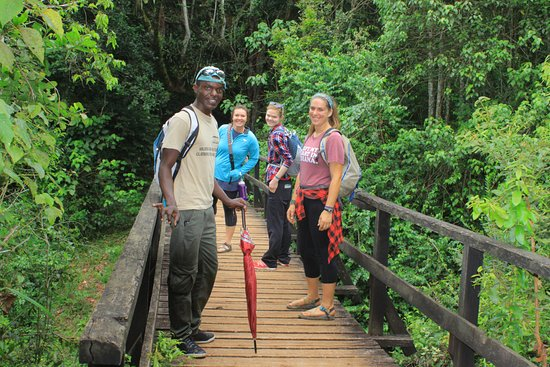 clients-crossing-the-river-kilimanjaro day tour